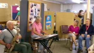 Participants and Volunteers enjoying local entertainers Bette Libby and